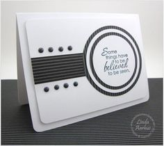 handmade greeting card ... white and grays ... great graphic lines ... like this design ... striped paper  for a band of color and also in the multi-layered circle focal point ... luf how the layers make lines echoed by the stripes in the paper ... good use of brads ... great card!! ... Stampin' Up!