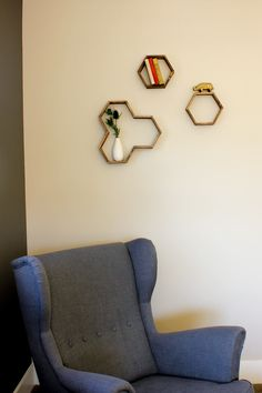 Make awesome mid century modern honeycomb shelves for less than $10 using popsicle sticks! These West Elm worthy hexagon shelves add warmth and dimension to any gallery wall and also look great on their own. Click for instructions and free downloadable template.   MakeAndDoCrew.com