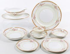 Lot 319: Noritake (M in wreath) China Service; Eight-seven items including (12) dinner plates, (12) bread plates, (11) dessert plates, (12) salad bowls, (12) fruit bowls, (11) coffee cups, (12) saucers, a creamer, a round covered casserole, an oval serving bowl, an oval platter and a gravy boat with attached underplate