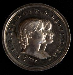 Numismática - medalha Brasil Império, prata, raríssima peça da visita das princesas Isabel e Leopoldina à Casa da Moeda, em 17-11-1856. Assinada por Luster F. 29mm, 15,27g.