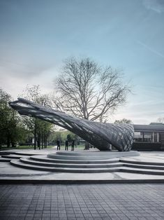 A team from the University of Stuttgart has used robots and drones to weave this carbon-fibre pavilion, which is based on the hammocks spun by moth larvae