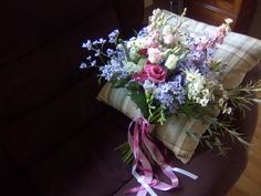 The Bride's bouquet in pink, lilac and white. A relaxed country garden style. Flowers by Honey Pot Flowers.  Venue The Tythe Barn, Bicester