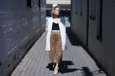 "4 New York Bloggers, 1 Full Month Of Looks #refinery29  http://www.refinery29.com/april-outfit-ideas#slide-3  Wednesday""Elegance and comfort is super-important in my book. A touch of camel added to a black-and-white outfit never fails me. I love these wide-legged cutoffs from H&M.""What She's Wearing: Agent Provocateur bustier, H&M coat and culottes, and Sigerson Morrison shoes."