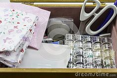 A display of a Sewing Box with Fabric