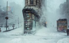 Photographer Michele Palazzo woke up extra early to capture this stunning   image of the Flatiron building in New York during Storm Jonas