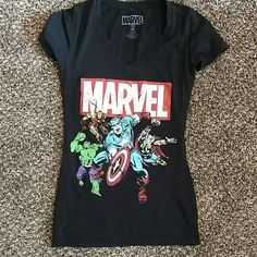 Marvel V neck tee Medium tee shirt with the Marvel avengers pictured. I just don't have a ton of places to wear this shirt anymore. Tops Tees - Short Sleeve