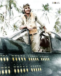 USMC. 2nd Lt. William Magill DFC is shown in his F-4U Corsair fighter. For 15 months in the Pacific he flew the plane on 89 combat missions, as represented by the bombs painted on its side.
