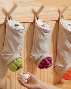 Vegetable Keep Sacks, small size is designed for garlic, the medium for onions, the large for potatoes.  Made from a cotton and linen fabric that allows air to circulate but blocks out light to prevent sprouting. They have drawstrings with toggles for easy filling and dispensing.
