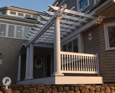 entrance is dynamically accented with a pergola attached to the house ...