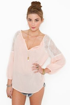 love this shirt, but I'm afraid it will wrinkle like crazy. $48