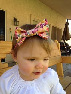 Floral bow headband. Available at www.etsy.com/shop/thelittlebowco