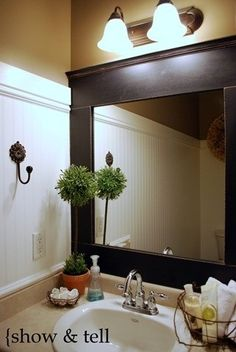 Framed Mirror....DIY - Fun Bathroom ideas too  Love the look of the mirror mixed with some industrial fixtures.
