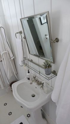 tile floor, pedestal sink, board & batten walls, neutral