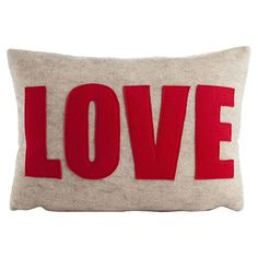 Featuring a bold typographic motif and appliqued detailing, this eco-friendly felted accent pillow adds a pop of color to your sofa, loveseat, or chaise.