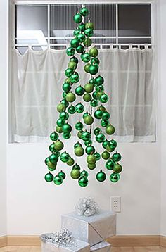 Christmas Tree Ornament Mobile | 12 Totally Unique DIY Christmas Decorations, see more at http://diyready.com/12-totally-unique-diy-christmas-decorations