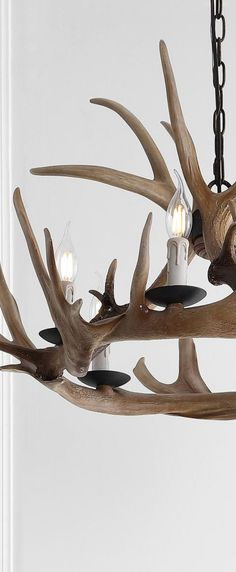 Jonathan Y Antler Chandelier: Constructed from resin, this beautiful chandelier adds a touch of rustic elegance to any space. #rusticlighting #rusticchandeliers #farmhouselighting #farmhousechandeliers #antlerlighting #antlerchandelier #decoratingideas #rustic #farmhouse #chandeliers #loghomes #logcabins