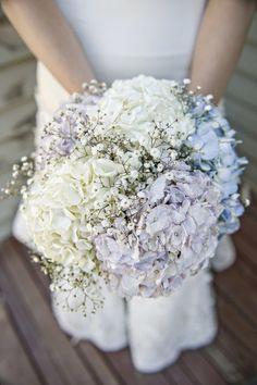 Wedding bouquet of blue and purple hydrangeas with baby's breath {@jasonbphoto}
