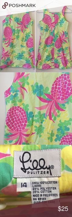 Girls Lilly Pulitzer Pineapple Sundress 14 Lilly Pulitzer green/yellow strappy dress with blue, yellow, and green flowers and pink pineapples.  Girls size 14. 65% polyester, 35% cotton. Good used condition, no stains or rips. Lilly Pulitzer Dresses Casual