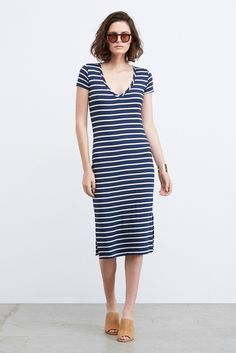 FREE SHIPPING - FREE RETURNS Miley is the perfect go to dress for every day of the week. Cut from our super-soft stretch modal jersey, this short sleeve under the knee dress features a deep v-neckline