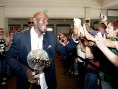 Donald Driver greets employees at Northwestern Mutual holding his hardware.