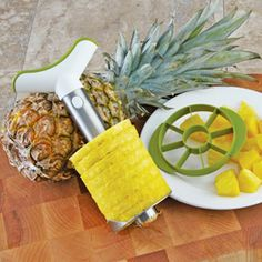 Shop Pineapple Corer and Slicer with Wedger at CHEFS.  I will buy this for sure.  So near. And so much cheaper than buying canned... just make fresh and freeze