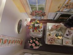 Nov. 30, 2014 - Moving to the left side of the bag, the second plate is seen on the wall next to a crosstitched bell pull by Marcia Benatti.  Two floral displays sit between the table and the wall.  The printed design on the back wall can also be seen.