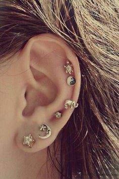 Perfect hipster earrings. Multiple ear piercings are so attractive