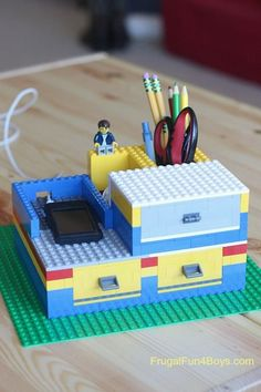 Build a desk organizer with working drawers – out of Lego bricks! Aidan and I had fun building this Lego desk organizer. The drawers really open and close, and we included a charging station for his iPod. The basic concept of this design is so simple, and you could make all kinds of variations to …
