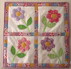 Pictures of patchwork and applique miniature quilts offer plenty of inspiration for your next mini quilting project.: Flower Garden Doll Quilt