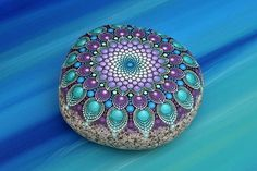 Reserved for Adam Feathermoon hand-painted stone mandala
