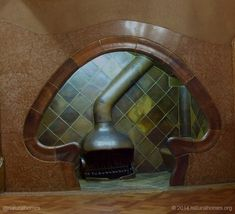 The alcove is a small space on the edge of a room which is large enough for a few people to sit and chat but open to the room so that everyone is still together. This is the alcove in the entrance lobby of Gaudi's Casa Batllo in Barcelona, Spain.