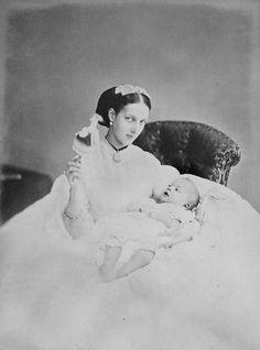 """Alexandra, Princess of Wales, June 1864, holding Prince Albert Victor. """