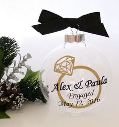 Personalized Engagement Ornament, Engagement Gift, Just Engaged Gift, Engaged Ornament, Custom Christmas Gift - This 4 clear glass disc ornament is personalized with wording in your choice of colors. Choose color from drop down menu. - Personalized with a Glitter Gold Diamond Ring, the couples name, the word engaged, and the date of the engagement. - Matching ribbon a the top of the ornament. - The ornament pictured is made with black wording and a black ribbon. - In a note to seller at ...