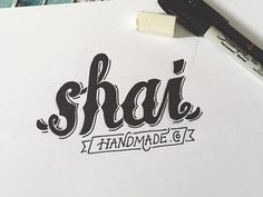a hand lettered logotype for Shai Handmade