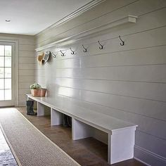 Gray mudroom boasts gray shiplap walls lined with a shelf ledge and a row of hooks over an extra long bench alongside a bound herringbone sisal runner. Rustic Entryway, Entryway Decor, Entryway Ideas, Gray Shiplap, Decoration Entree, Long Bench, Foyer Decorating, Decorating Ideas, Decor Ideas