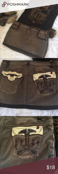 """Buffalo Brown Distressed Mini Skirt 5 pocket, brown distressed mini skirt. Corduroy on front pockets and trim. Right back pocket has button and stitched eagle embellishments, and leather on top of pocket. Left pocket, has a leather longhorn embellishment.  Size 9 approximate measurements are: length 12 1/2 """"                waist 17 1/2"""" Buffalo Skirts Mini"""