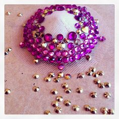 Making burlesque pasties with Swarovski crystals in shades of pink, fuchsia & gold. www.flofoxworthy.com