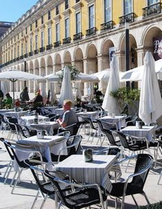 Grabbing some sun while having  a wonderfull meal or just an expresso or ginjinha (sour cherry #portuguese traditional spirits) Terreiro do Paço Square, near Tagus River #Lisbon #Portugal