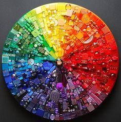glue gun the shazzit out of bits, bobbles and buttons onto a canvas in rainbow order? reminds me of eye spy...