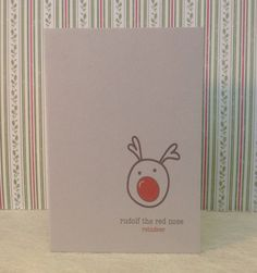 Rudolf's nose is huge, but I think he still looks cute on this simple understated christmas card!  This lovely contemporary christmas card is printed on beautiful 11 x 15cm grey speckled card.  It comes with a neutral envelope and wrapped in cellophane.  Code: LC08