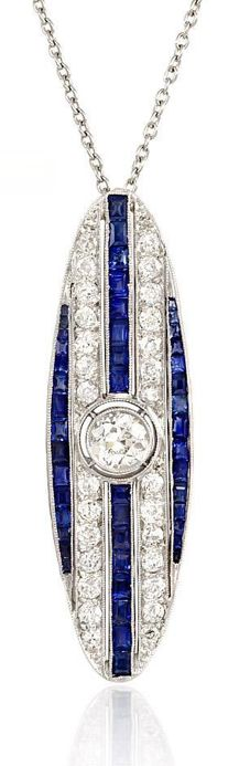 An Art Deco diamond and sapphire pendant of elongated oval design with a central Old European cut diamond, in platinum. Tw dia 1.90cts          Circa:    1925