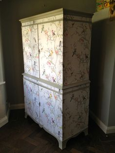 By Christina Valentine: Charles Burr Cabinet covered with Metallic Birds wallpaper. Painted with Farrow & Ball Hardwick White eggshell paint.