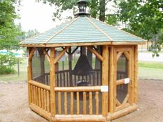 """Log Gazebo with optional """"Gazebeque"""". A fire pit with removable charcoal grill.Shown: Log Gazebo with optional """"Gazebeque"""". A fire pit with removable charcoal grill. Screened Gazebo, Backyard Gazebo, Fire Pit Backyard, Pergola Patio, Pergola Plans, Pergola Shade, Fire Pit With Rocks, Gazebo With Fire Pit, Courtyards"""