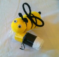 """Wash cloth/diaper """"Bee"""" with a """"tootsie rolls"""" - Great centerpieces or tabletops for any """"Parent-to-Be! Order at www.CornerStorkBakery.com"""