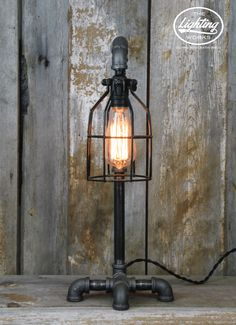 Diy Home : Illustration Description Steampunk Industrial Machine Age Lamp Add the perfect touch of steampunk style to any space with this unique lamp post style industrial table lamp! Crafted from a blend of electrical and plumbing comp -Read More – - Farmhouse Lamps, Rustic Lamps, Lampe Tube, Pot Mason, Vintage Industrial Decor, Industrial Lamps, Industrial Furniture, Pipe Lighting, Steampunk Lamp