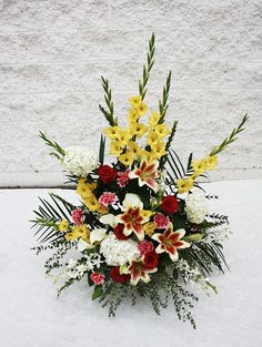A mache arrangement with yellow glads, lilies, hydrangea and a touch of roses - Four Seasons Flowers