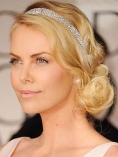 Brides looking for an alternative to a veil could try a bejeweled headband. We like Charlize Theron's Art Deco wrap. Getty Images -Cosmopolitan.com