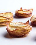 Mini Potato Gratins! Thinly slice potatoes. Put in buttered muffin tin top with cream and bake.