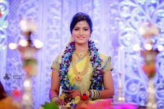South Indian bride. Kanchipuram silk sari. Temple jewelry. Braid with fresh flowers. Orchid flower garland.Tamil bride. Telugu bride. Kannada bride. Hindu bride.Malayalee bride.