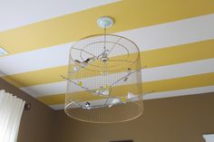 I am actually attracted to the striped ceiling.  Birdcage lamp tutorial